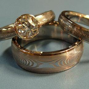 Infinity Damascus Wedding Set with Bezel Set Diamond