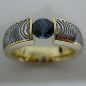 Tension Set Damascus Ring with Sapphire